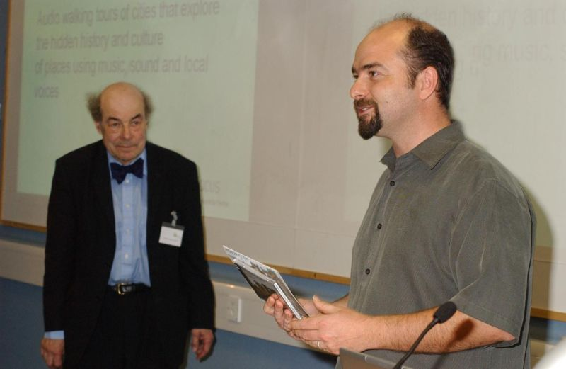 Picture of author receiving award from Heinz Wolff
