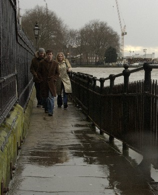 Picture of people walking along walkway today in the rain